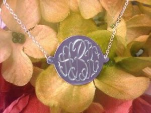 10 K or 14 k solid gold disc with personalized initial engraving.